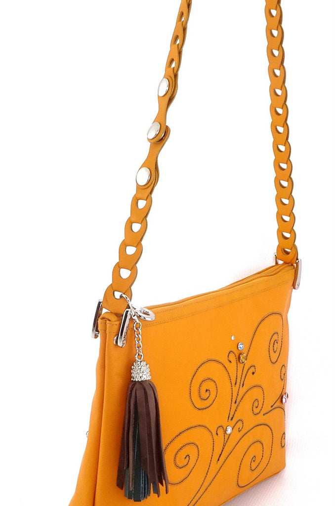 Rosie Mustard leather stitched swirl details small tote bag side view