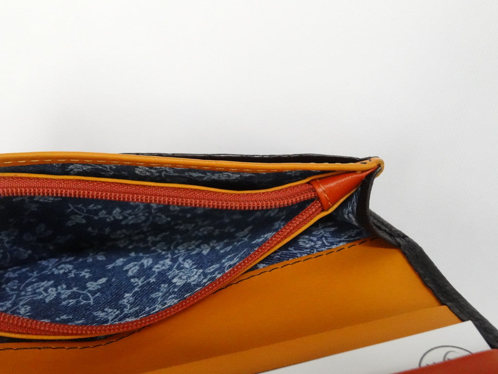 Caitlin  Black ostrich mango & orange detail ladies purse showing coin zip section