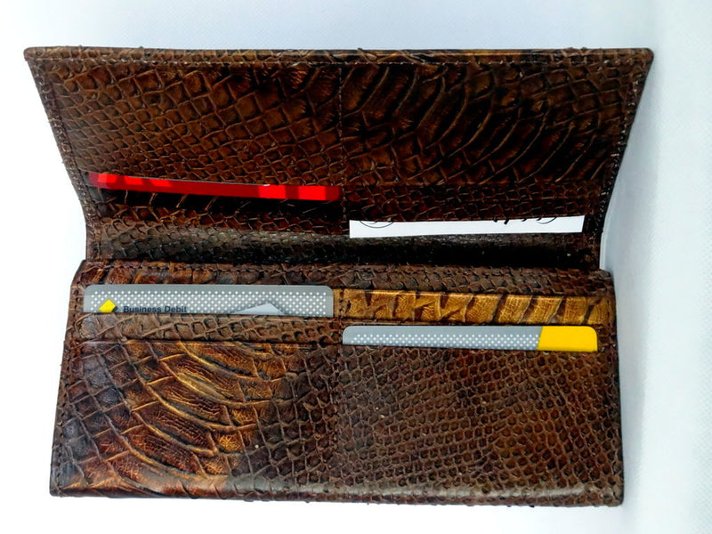 Caitlin  Copper snake print leather ladies purse showing inside in use