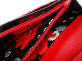 Caitlin  Black leather with red accents ladies purse showing coin zip section