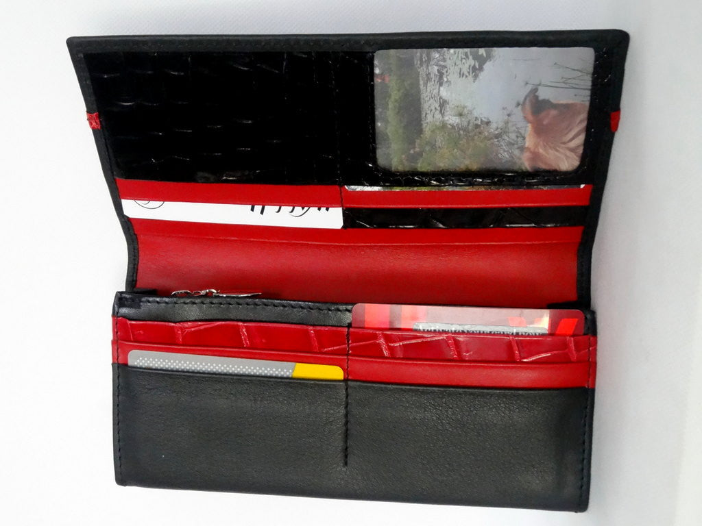 Caitlin  Black leather with red accents ladies purse inside view showing in use