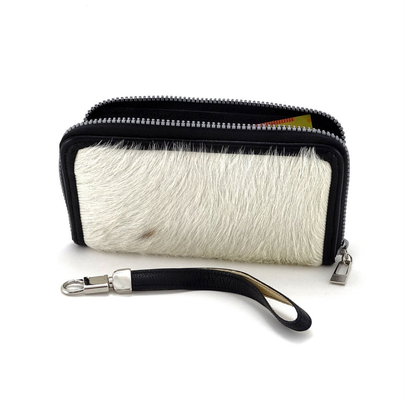 Victoria  White hair on cow hide leather ladies zip around purse side view zip opne