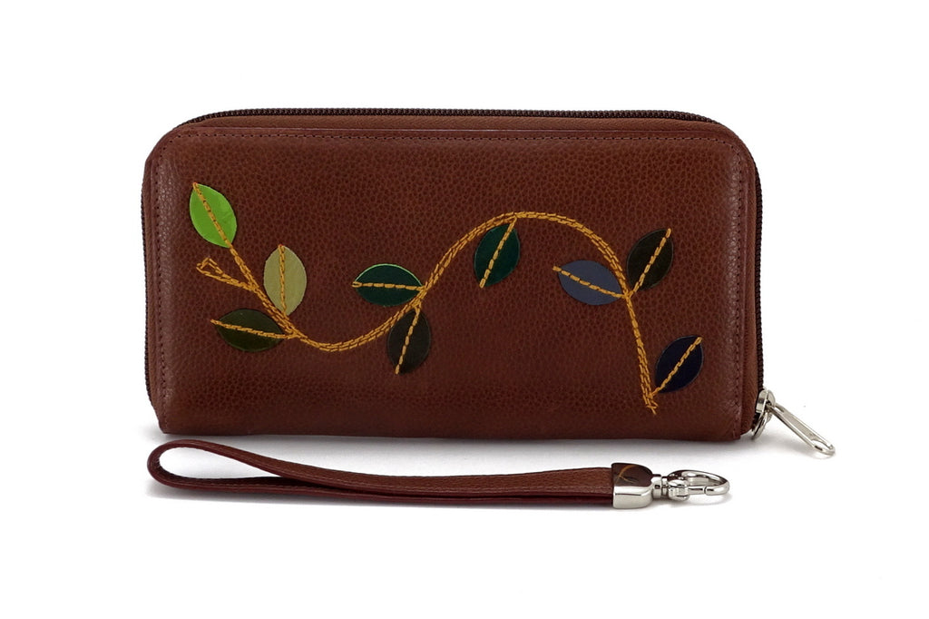 Victoria  Mid brown leather vine detail ladies zip around purse view side 1  green leaves