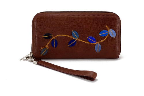 Victoria  Mid brown leather vine detail ladies zip around purse view side 2 blue leaves