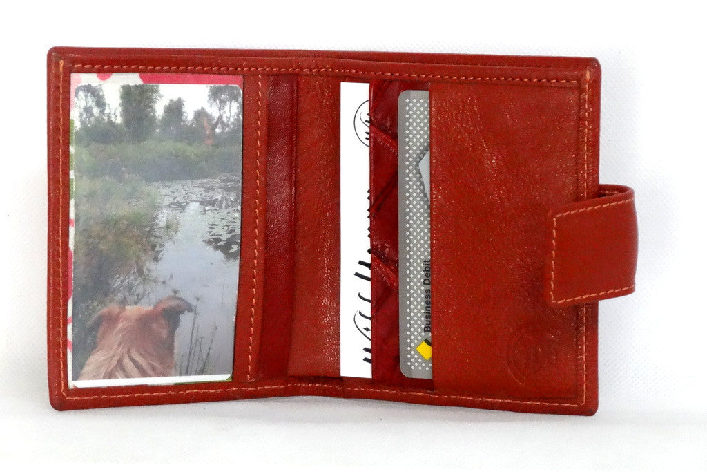 Christine  Rust lightly textured leather small ladies purse wallet inside picture window