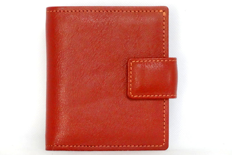 Christine  Rust lightly textured leather small ladies purse wallet front tab closure