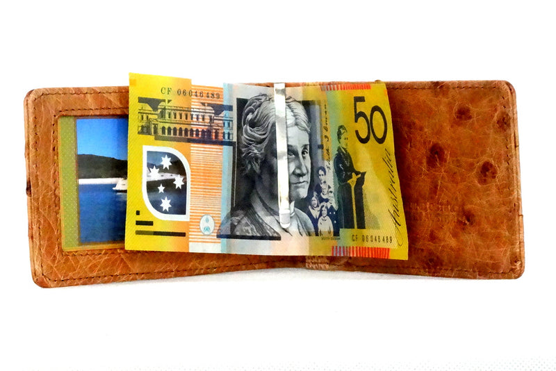 Tan ostrich bill fold showing money clip in use