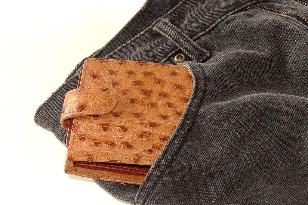 Harrison  Tan ostrich skin men's large leather hip wallet showing going into front jeans pocket