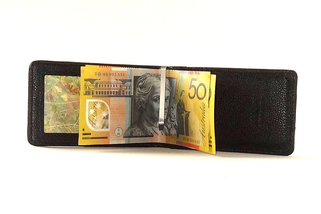 Bill fold wallet inside view black leather showing with notes in money clip