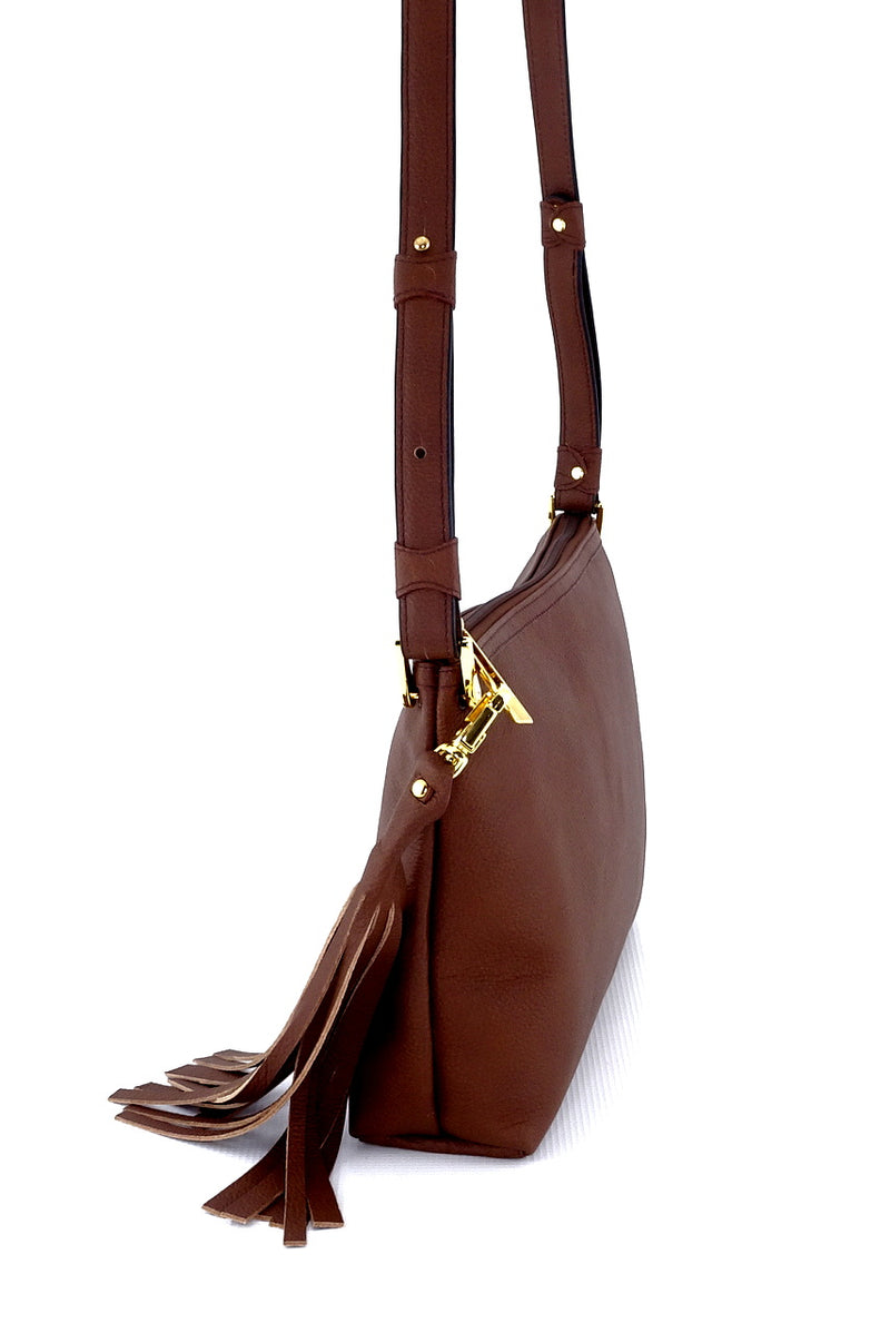 Rosie Brown textured leather small tote bag leather lined large tassel showing strap adjustment