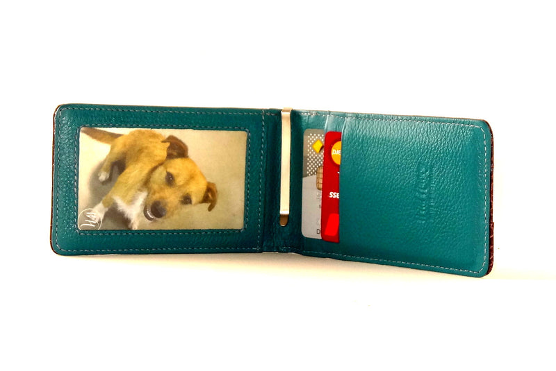 Billfold teal leather showing inside view picture window and credit pockets in use