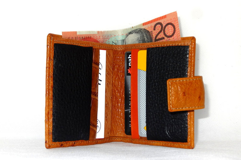 Christine  Tan ostrich chick skin small ladies purse wallet showing inside in use
