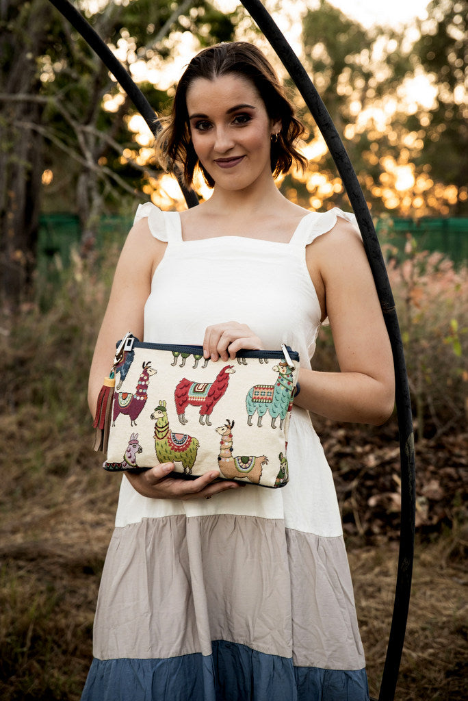 Rosie Llama printed fabric leather lined small tote bag showen with model