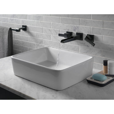 Delta Ara Collection Matte Black Finish Two Handle Wall Mount Bathroom Lavatory Sink Faucet with Channel Spout Includes Rough-in Valve D2090V