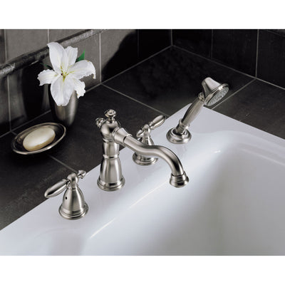 Delta Victorian Collection Stainless Steel Finish Traditional Roman Tub Filler Faucet with Hand Shower INCLUDES (2) Lever Handles and Rough-in Valve D1420V
