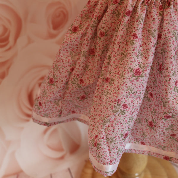 Pink Skirt with Roses and a White Ribbon