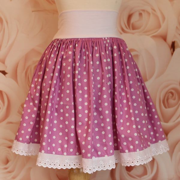 girls pink polka-dot skirt with white lace on a white knit waist band