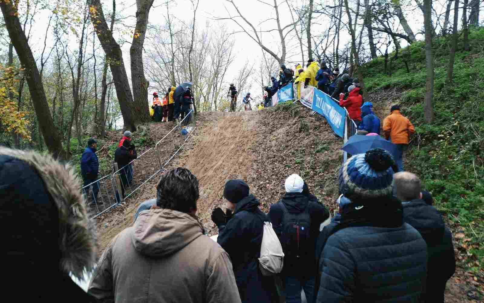 Cyclist in cyclocross race coming down hill