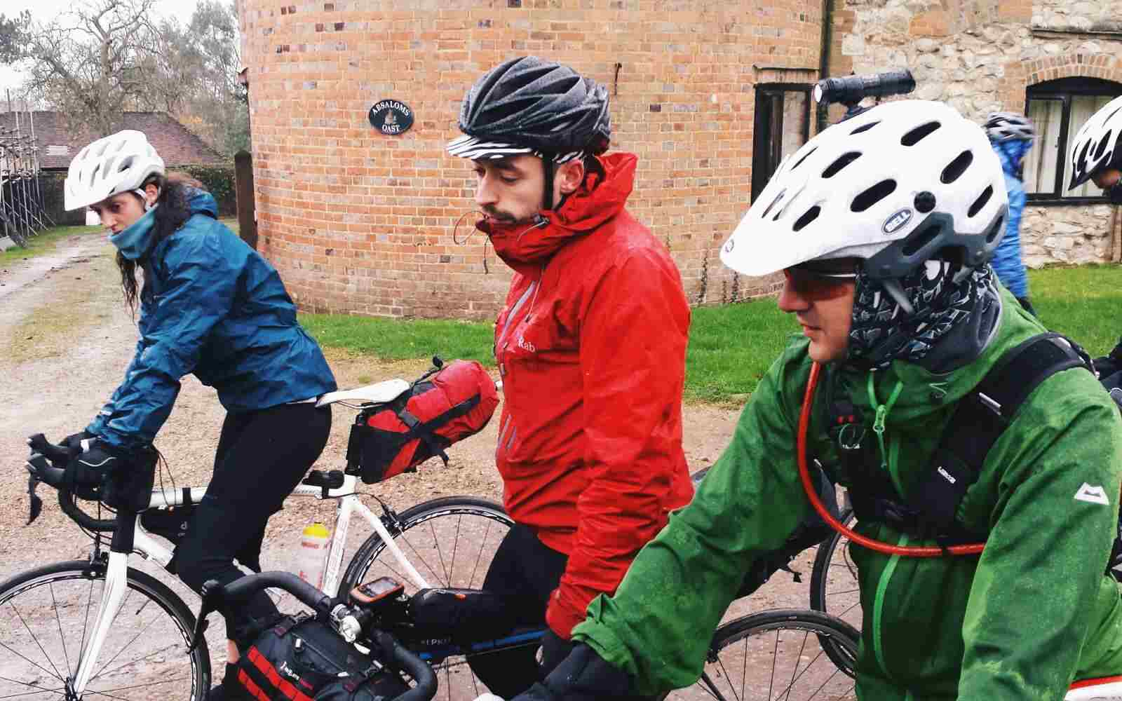 Cyclists in the rain bike packing