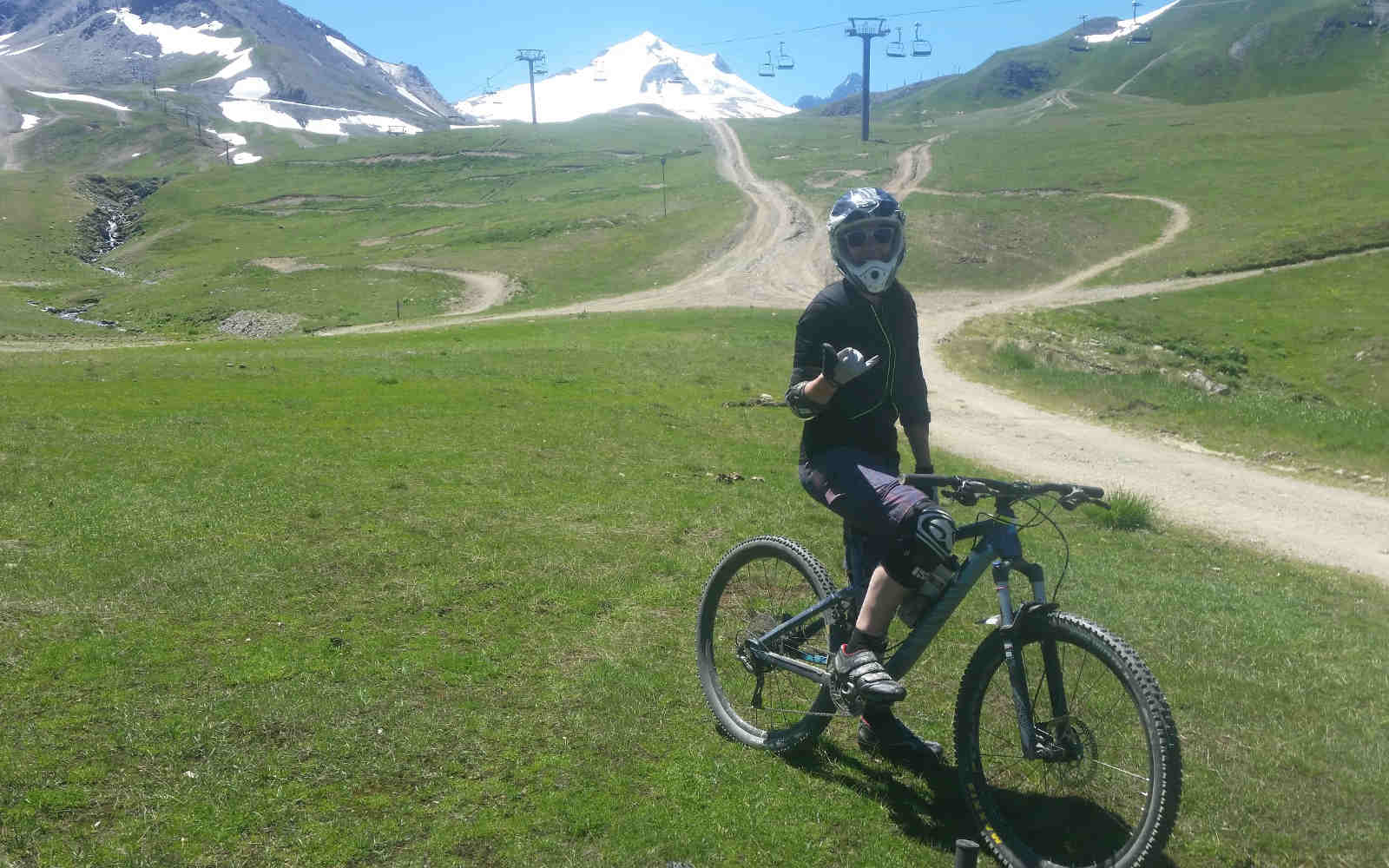 Downhill mountain biking in Tignes landscape with lifts