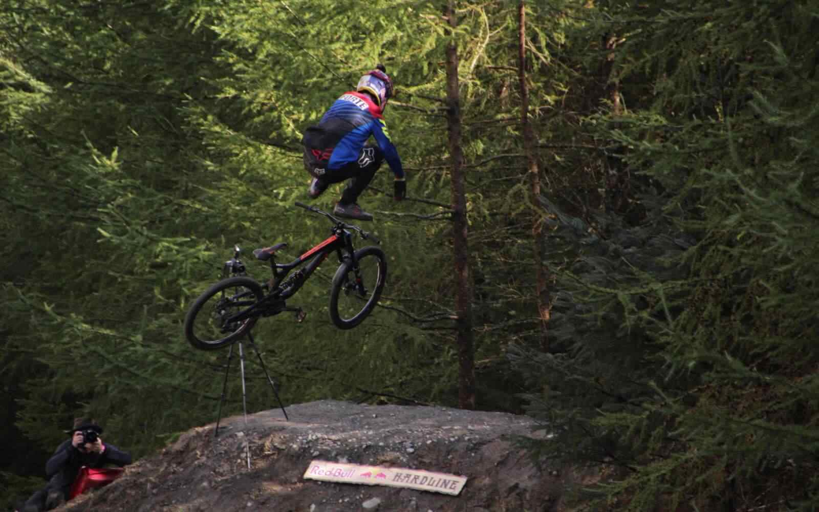 Moutain biker falling off bike mid air Red Bull Hardline