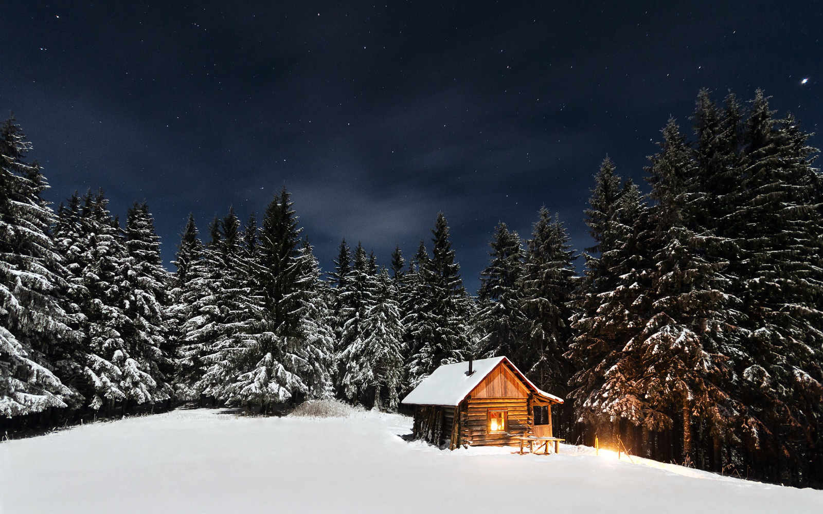 Remote winter cabin in the snow, photo by Paul Itkin