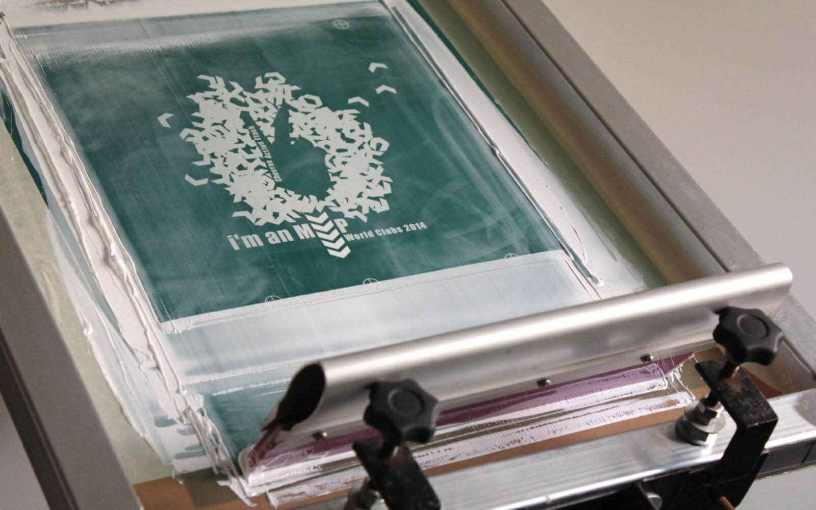 White layer on the printing press printing bespoke design for Chevron