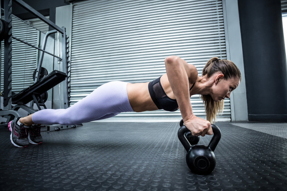 woman kettlebell push up