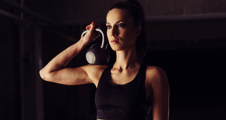kettlebell on woman's shoulder