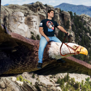 man wearing a grunt style graphic tee while riding an eagle