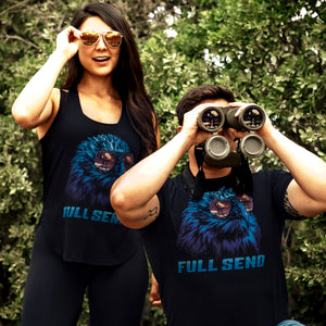 Man wearing the Full send short sleeve tee and woman wearing the tank top that has the America eagle wearing sunglasses graphic logo