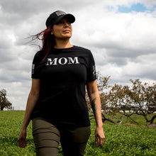 Load image into Gallery viewer, Woman wearing the Women's Mom Defined Graphic Tee in the relaxed fit