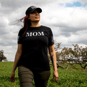 Woman wearing the Women's Mom Defined Graphic Tee in the relaxed fit