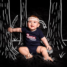 "Load image into Gallery viewer, Baby modeling the Born Badass Runtsie™ that says ""Born Badass"""