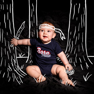 "Baby modeling the Born Badass Runtsie™ that says ""Born Badass"""