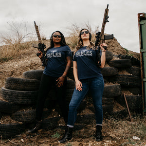 Two Women modeling the Rifles are a Girls Best Friend Women's Relaxed Fit Short Sleeve Graphic Tee in Navy