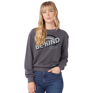 "Woman modeling the Women's Be Kind But Stay Frosty Terry Crew Sweatshirt that says ""Be Kind But Stay Frosty"" on the front"