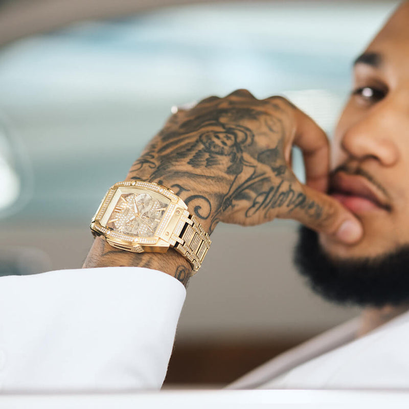 Moe City with the JBW gold PS Echelon diamond watch