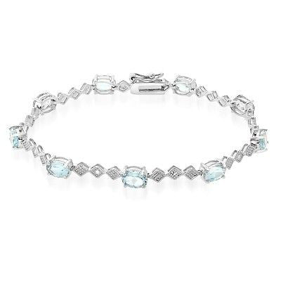 9 CARAT OVAL BLUE TOPAZ AND DIAMOND BRACELET IN RHODIUM PLATED BRASS