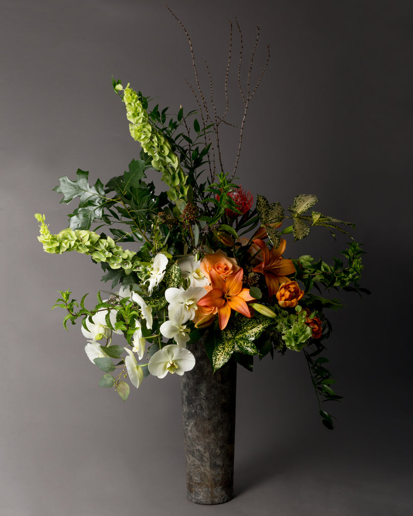 Draping orchids, eclectic florals & foliage, tigerwood, stone container