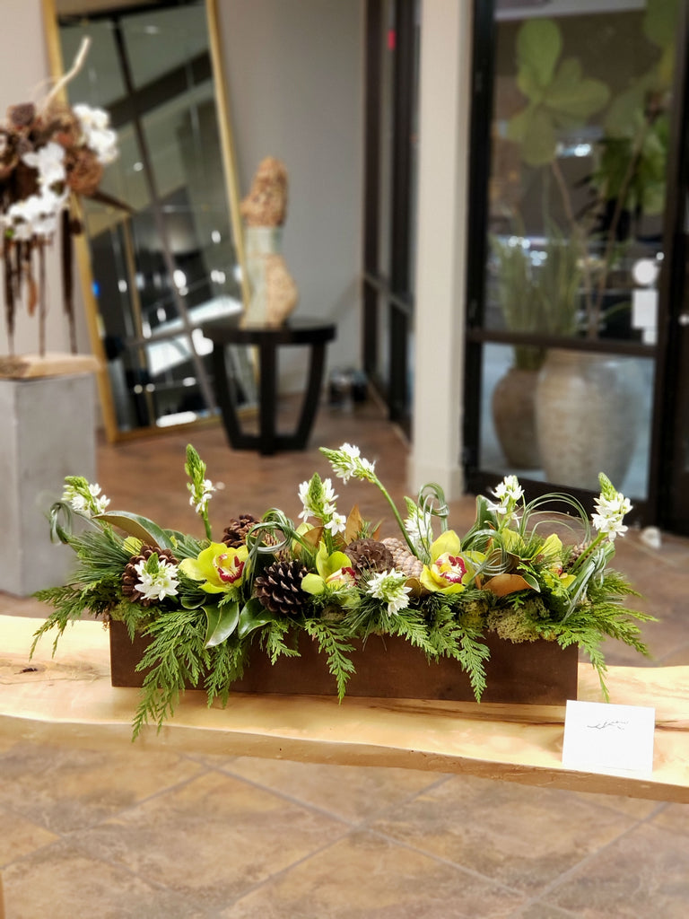 Low & wide, cymbidium orchids, pinecones, rustic metal container