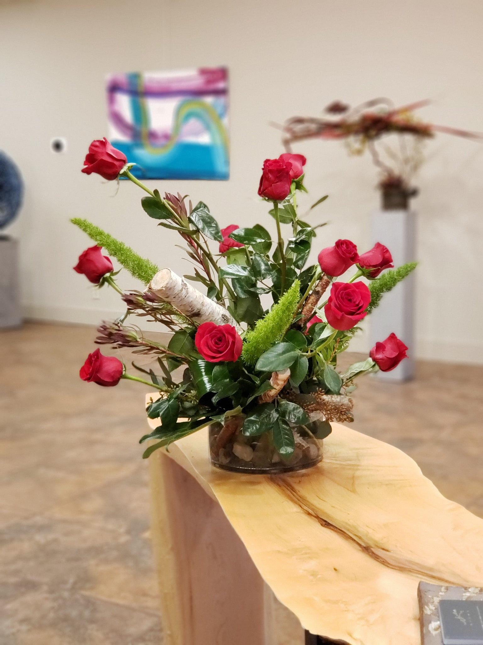 All-rose centerpiece, height variance, birch wood poles