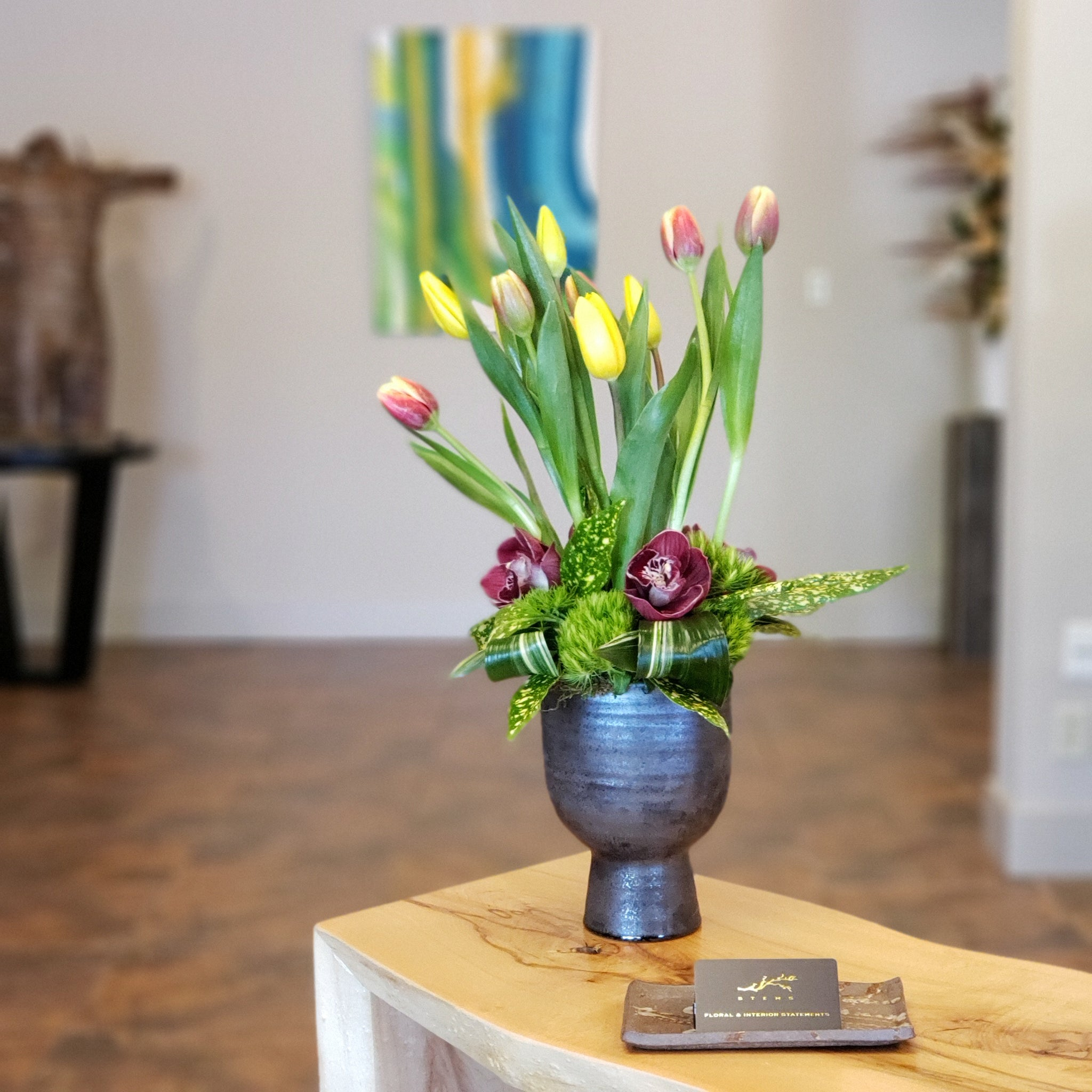 Brimful cymbidiums, 2 bunches of loose tulips, ceramic container