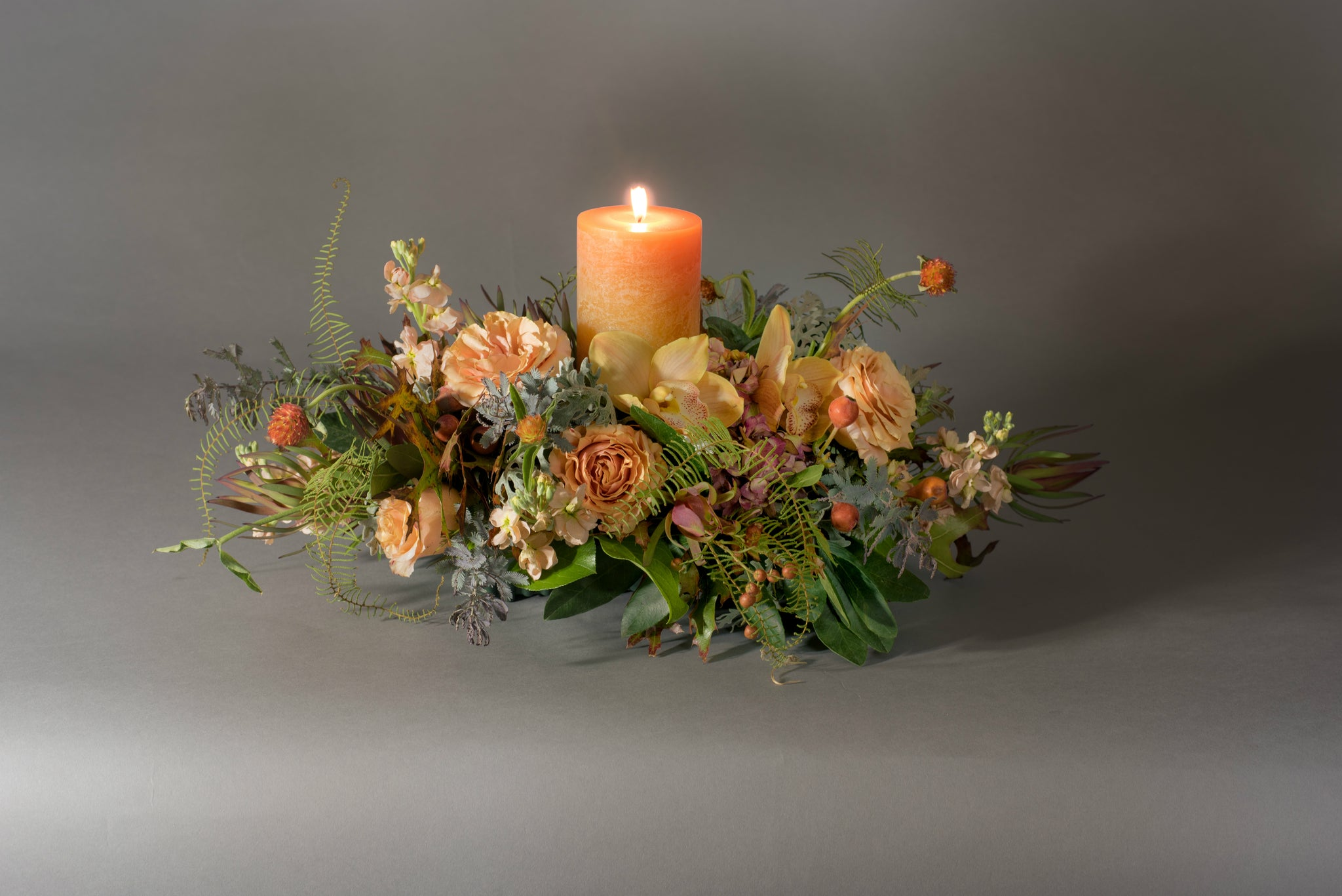 Low & lush centerpiece with timber candle