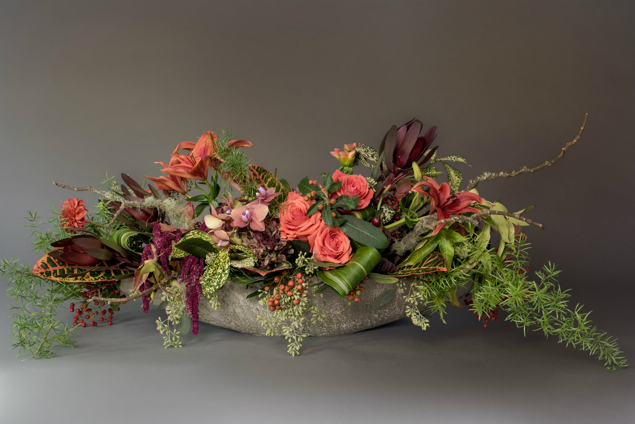 Wild & Eclectic centerpiece mix in a stone container