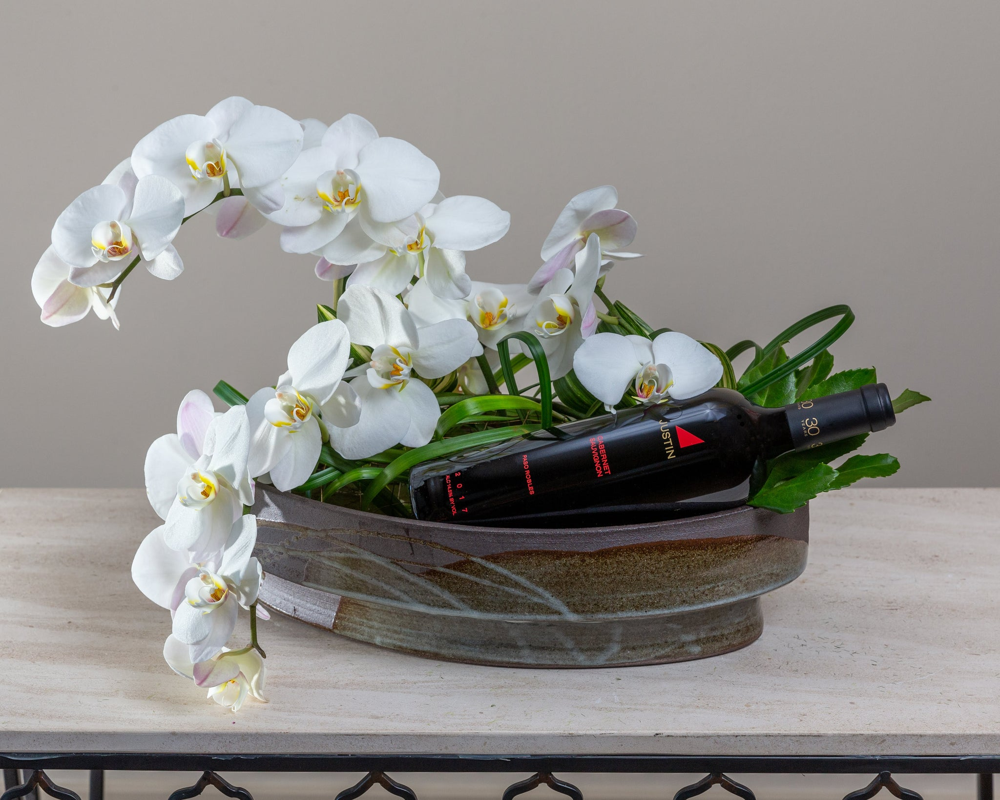 Orchids & foliage, Arakawa designer container, complimentary bottle of wine