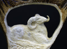 Medium sized hand carved moose antler on spruce--Dall Sheep