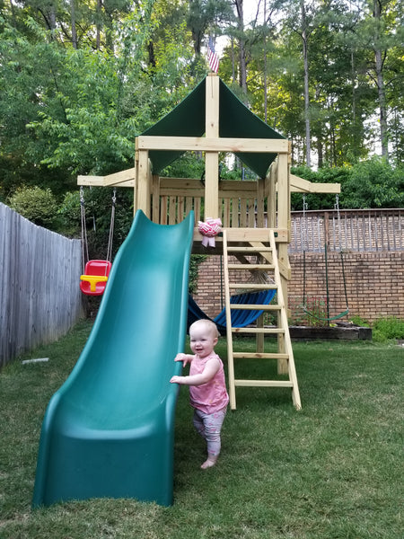 The Pathfinder Swing Set Space Saver Edition from The SwingSet Co. is great for family time and friends for outdoor play. It is a great small backyard playset with many accessories for multiple activities including an extra large fort, a belt swing, trapeze bar, 10' wave slide and an under fort hammock.