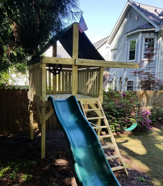 The Pioneer Space Saver Edition Swing Set from The SwingSet Co. is great for family time and friends for outdoor play. It is a great small backyard playset but ample room for activities. There are many accessories for multiple activities including extra large fort, a belt swing, 10' wave slide and an under fort hammock.