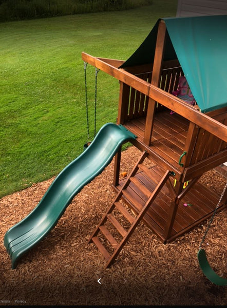 The Pathfinder Swing Set Space Saver Edition from The SwingSet Co. is great for family time and outdoor play. It is a great small backyard playset with many accessories including an extra large fort, a belt swing, trapeze bar, 10' wave slide and an under fort hammock.